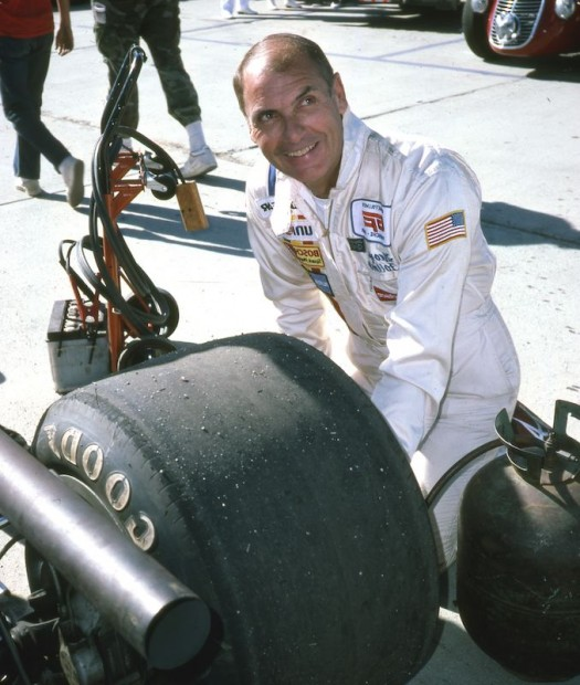 Ever the detail-man, George Follmer checking the tire on the Tyrrell-Ford before the Vintage Formula One event. Follmer led for a time when Dan Gurney passed him in the Eagle. At the end, Bob Bondurant in Don Wassermans 1967 Formula One Ferrari passed both to take the checker.