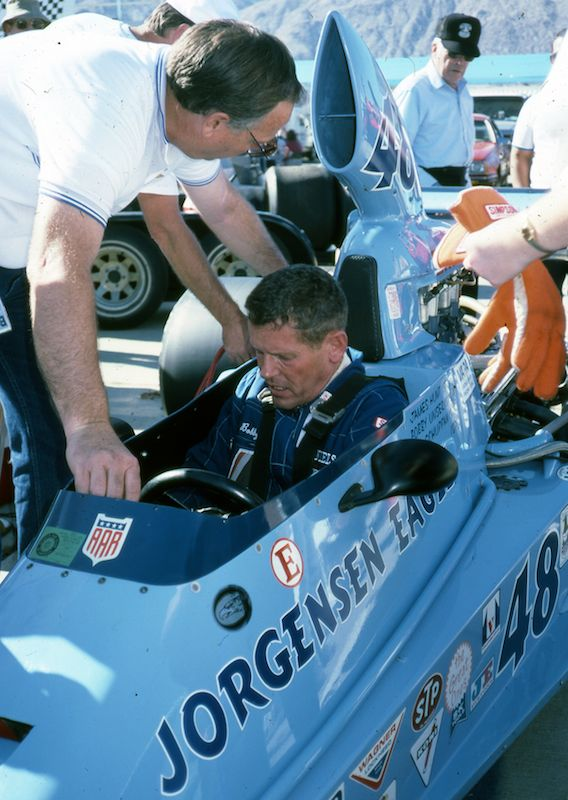 Bobby Unser drove the Indy-winning Eagle, then owned by Ron Kellogg (standing).