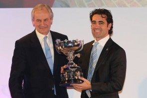 Dario Franchitti receives the 2012 Earl Howe Trophy from BRDC Chairman Stuart Rolt