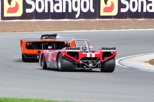 Bob Houghton Lola T210 chases one of the larger Lola T70s round Luffield