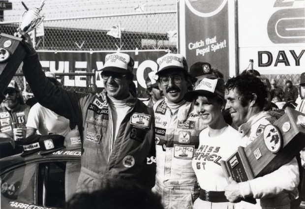 Brian Redman, Bob Garretson and Bobby Rahal in Victory Lane after winning the 1981 24 Hour Pepsi Challenge with the no. 9 Red Roof Inns Porsche 935.