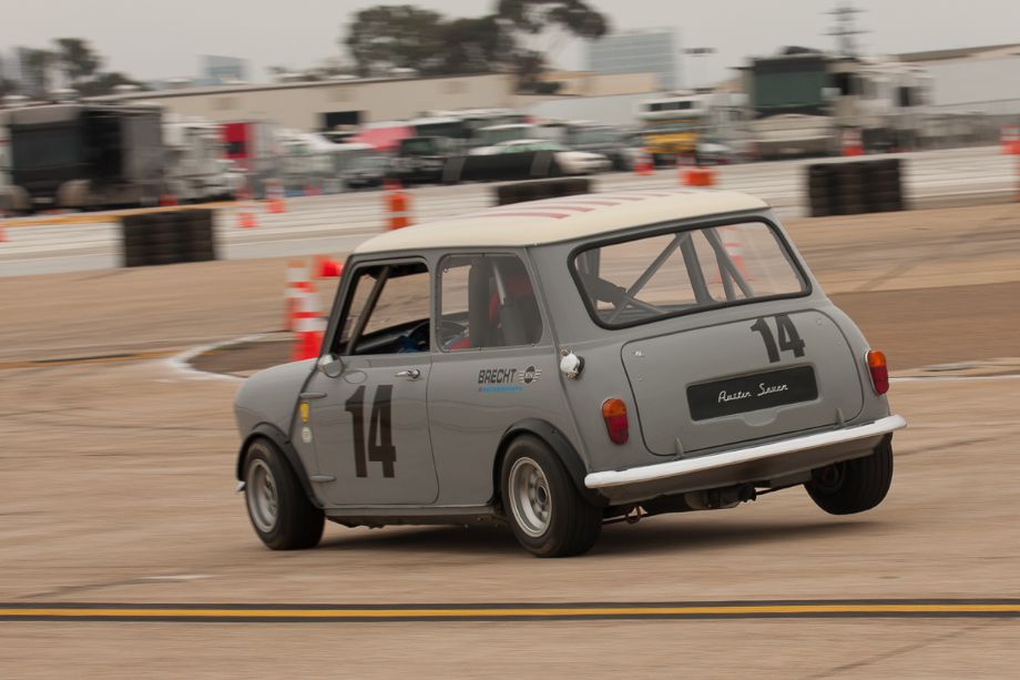 Tim Brecht lifts the right rear tire of his 1960 Austin Mini Cooper S, as he enters turn six.