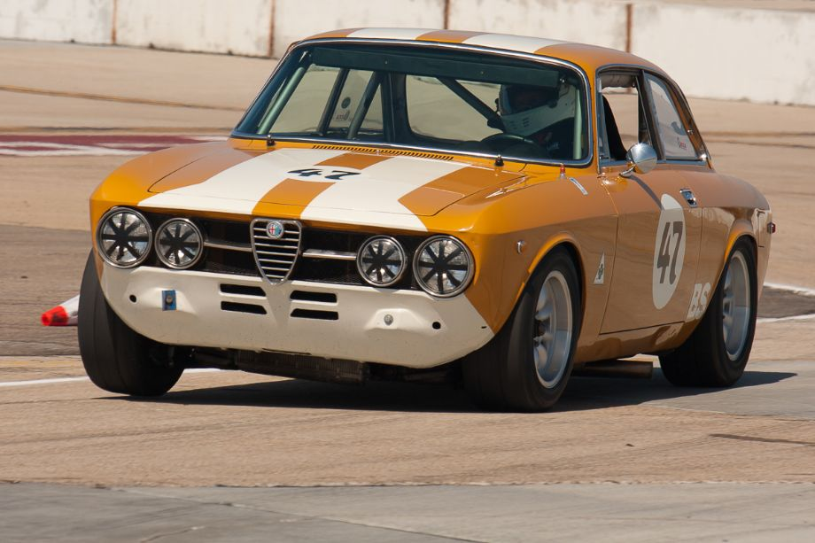 Dennis Daugs almost gets the right front tire of his 1969 Alfa Romeo, off the ground.