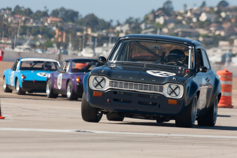 Francois Castaing keeps the Porsches at bay in his 1970 Ford Escort R8.