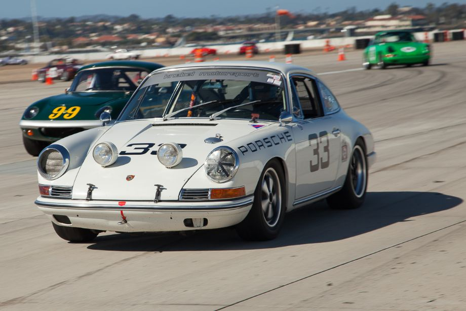 Dean Watts in his 1964 Porsche 901 - just ahead of the #99 Lotus.