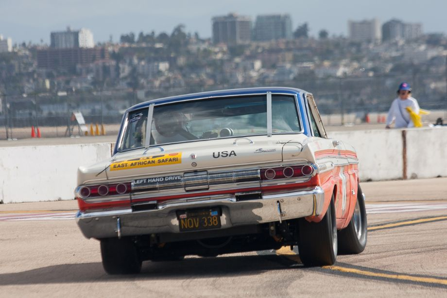 The corner worker looks on as Greg Umphenour takes his 1964 Mercury Comet through turn six.