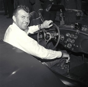 Carroll Shelby at the wheel of a new Cobra production car