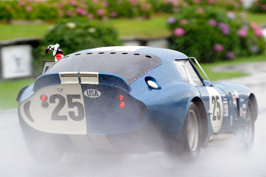 Kenny Brack celebrates after winning the rainy RAC Tourist Trophy Race in the Shelby Daytona Cobra Coupe - 2011 Goodwood Revival
