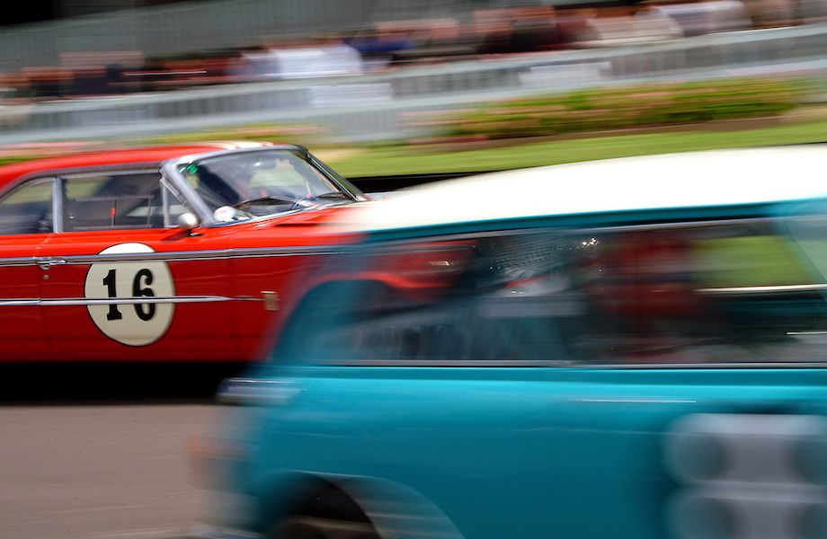 Ford Galaxie and Mini Cooper S blur down the front straight