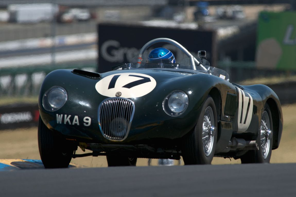 1953 Jaguar XK 120C Chassis No. 053 Chassis 053 is the last of C Types built in 1953 and one of the three lightweight C Types built in 1953. These three Lightweight cars used disc brakes, thiner alloy body panels mounted to thinner and smaller chassis tubes. Weber carburetors were used for the first time on a factory Jaguar race car. The rear suspension was modified with Panhard Rod and upper trailing arms. The three lightweights were among the first racecars to use a rubber bladder fuel cell. O53 Was a factory car in 1953 then migrated to the Ecurie Ecosse team in 1954. 053 Is the only lightweight retaining it's original bodywork. 1953 LeMans 24 Hours Moss/walker 2nd OA. 1953 Lisbon Gran prix Moss 2nd OA 1953 Goodwood Nine Hours Whitehead/Stewart 3rd OA 1953 Tourist Trophy Moss/Walker 3rd OA 1954 Castle Combe Stewart 2nd OA 1954 Zandvoort Sanderson 1st OA 1954 Barcelona Sanderson 3rd OA Engine: Jaguar 3.823cc DOHC inline 6, iorn block with aluminum cylinder head, wet sump, 12.0 to 1 compression, three Weber 45 DCO3 carburetors. 323 b.h.p. with a 6,500 r.p.m. redline. 146 m.p.h. top speed with the current gearing. Dunlop Disc brakes with six piston front and four piston rear calipers. The gearbox drives a hydraulic brake booster. For the 2014 Sonoma Historic Motorsports Festival 053 carries the number 17 as it did during the 1953 Le Mans event. 053 is being driven by Dyke Ridgley.