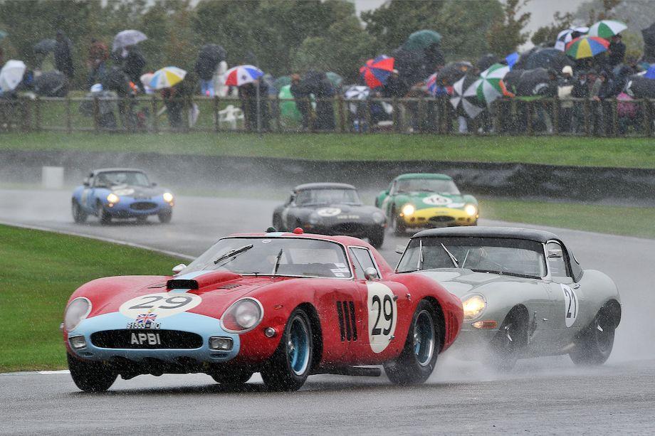 Ferrari 250 GTO/64 and Jaguar E-Type dancing in the rain at the Goodwood Revival (photo: Tim Scott)