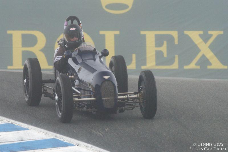Doug Mockett's 1961 Cooper T61 in turn eleven.