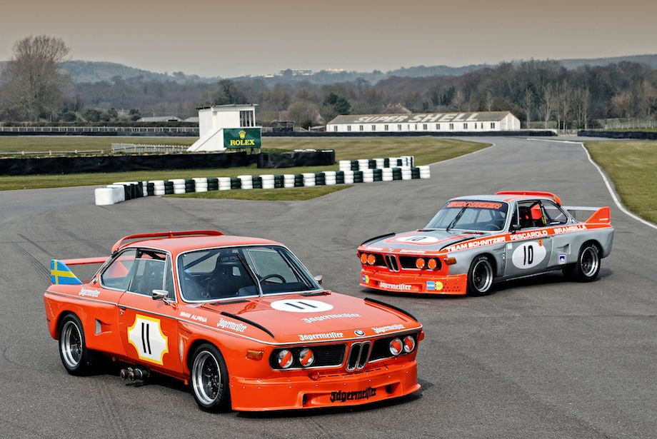 Bright orange BMW CSLs pose on Goodwood Circuit during Press Day