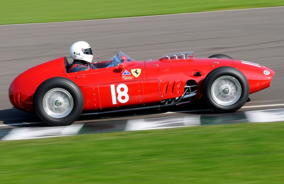 The red of the Ferrari 246 F1 contrasts nicely against the green grass at Goodwood