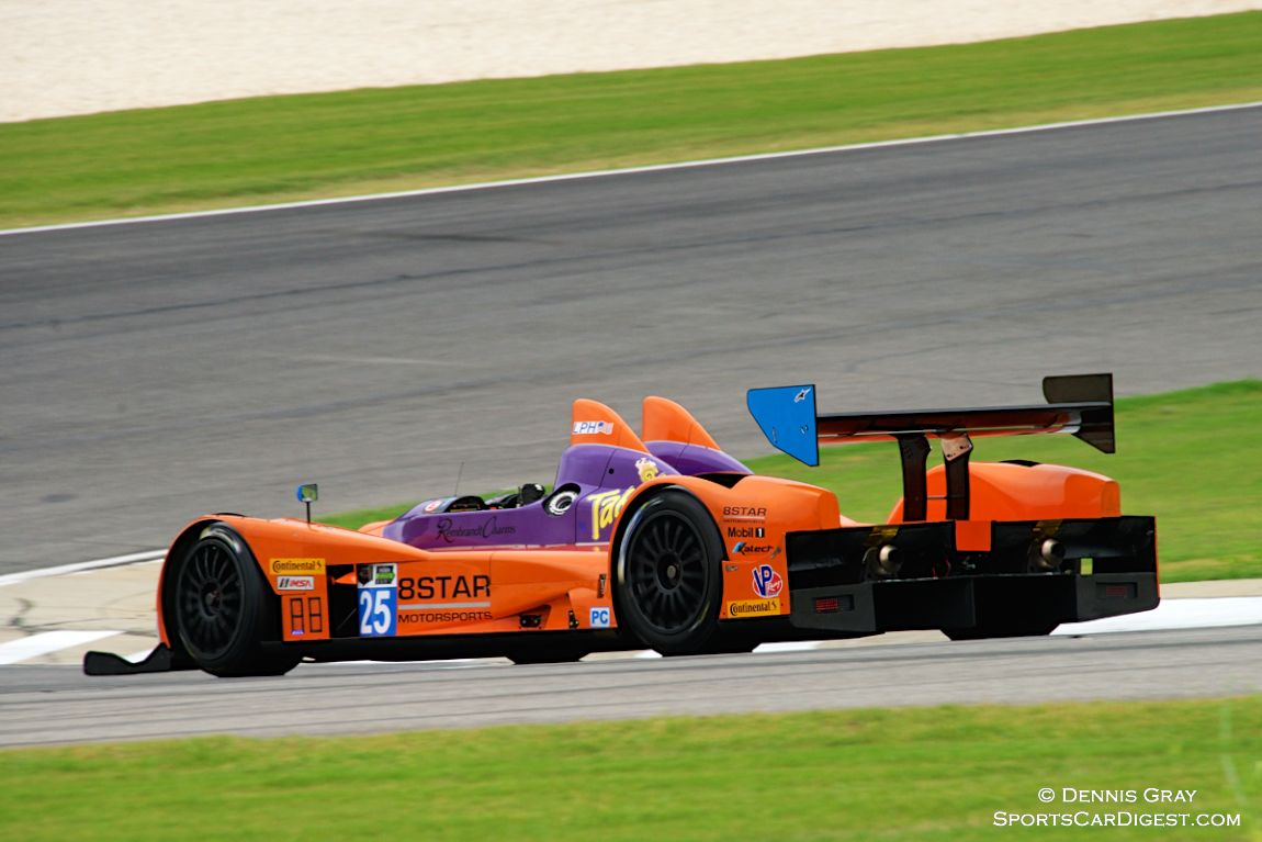 Lawrence Huang's Oreca FLM 09 drops down the hill into Turn 9