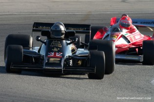 Chris Locke's 1976 Lotus 77 F-1 leads Chris MacAllister's 1976 Ferrari 312 T2 in turn eleven.