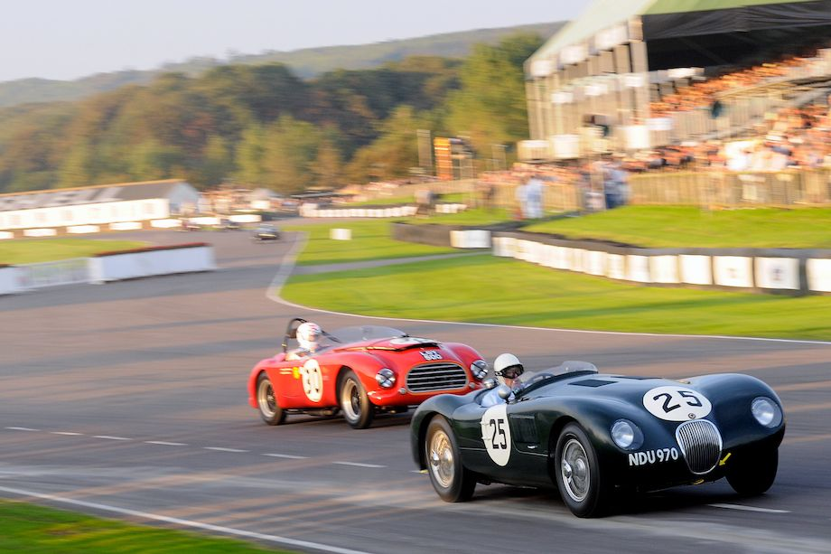 Stirling Moss in the Jaguar C-Type tries to stay clear of the Tojeiro-Bristol