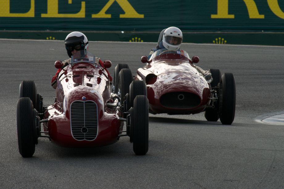 Paddins Dowling's Maserati 4CL and Jeffrey O'Neill's Maserati 250F drop into The Corkscrew.