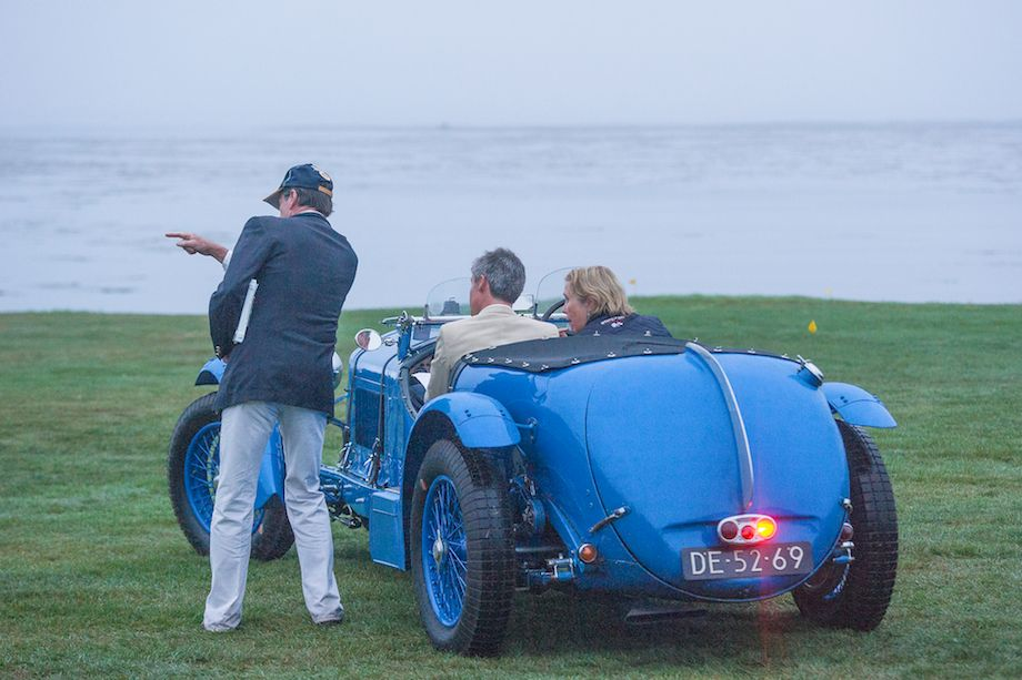 Alfa Romeo 8C gets parking directions at Pebble Beach Concours