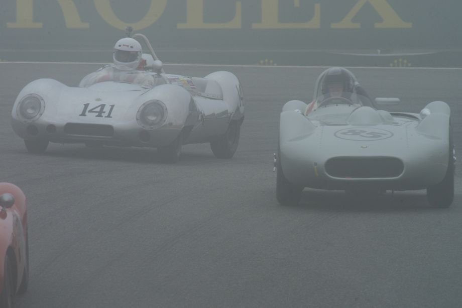 On the left, James Lawrence in his Lotus 15. On the right, Stephen Bond's Lister Bristol as they negotiate The Corkscrew.