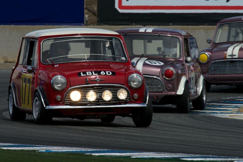 Dennis Racine's Morris Mini Cooper S leads the Mini Parade through turn eleven Sunday.