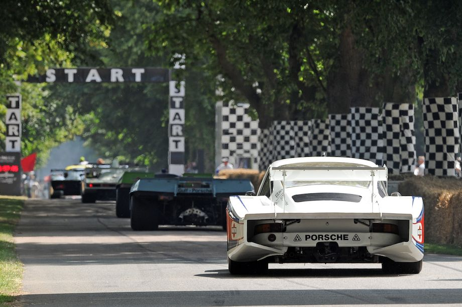 Parade of Porsches heads down open straight