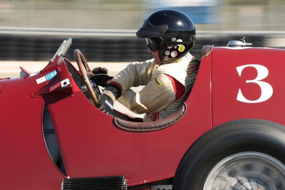 A study in concentration Three. Peter Giddings in his 1935 Alfa Romeo Tipo C 8C-35 drifts through eleven. Just incase any readers missed how difficult these prewar GP cars are to drive quickly.