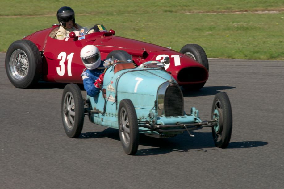 Sandy Green's 1925 Bugatti T35 inside Peter Gidding's 1953 Maserati 250F exiting turn fourteen.