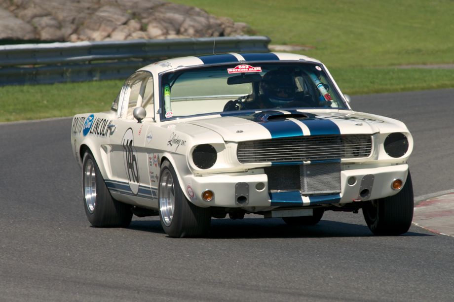 #146 is Jim Middleton's 1966 Shelby GT350H in turn fifteen.