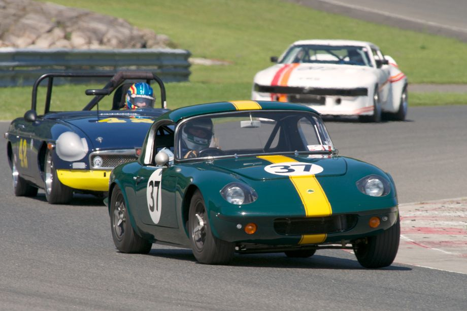 Michael Malone's very quick Lotus 26R leads through turn fifteen.