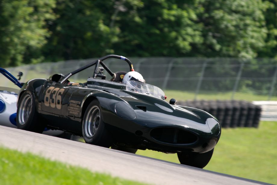#836 is Terry Lippincott's 1963 Jaguar XKE in turn twelve.