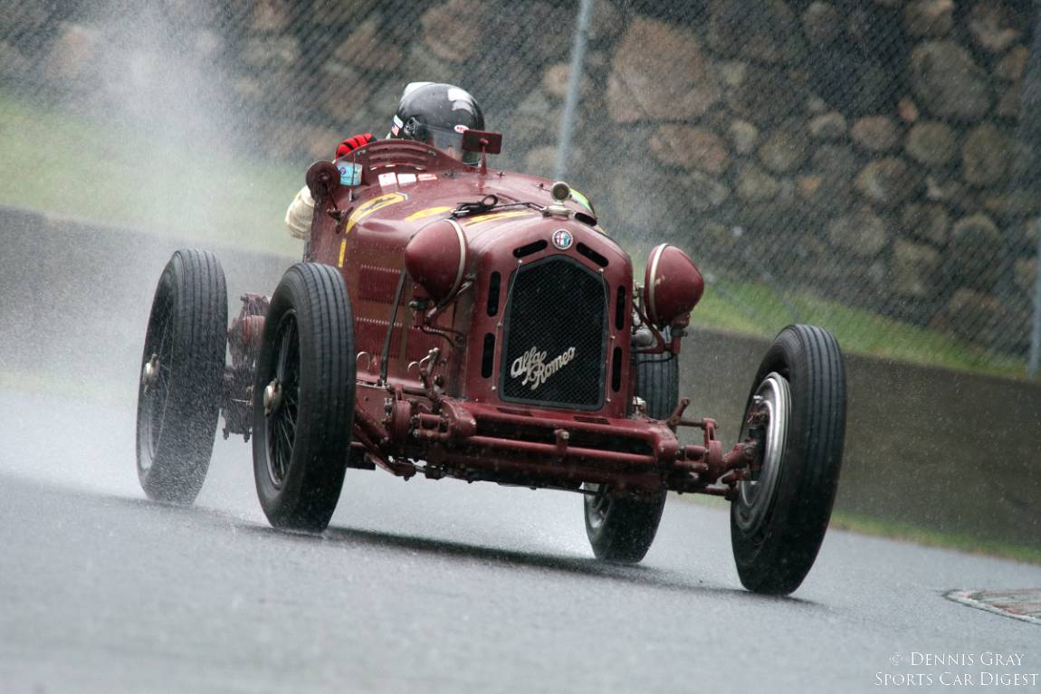As the Monsoon opens up Peter Greenfield's 1933 Alfa Romeo Monza 8C-2300 exits turn twelve.