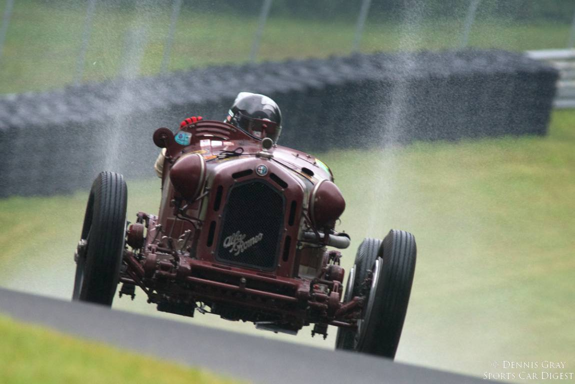 Peter Greenfield's 1933 Alfa Romeo Monza 8C-2600 up the hill into turn twelve during Sunday's Monsoon..