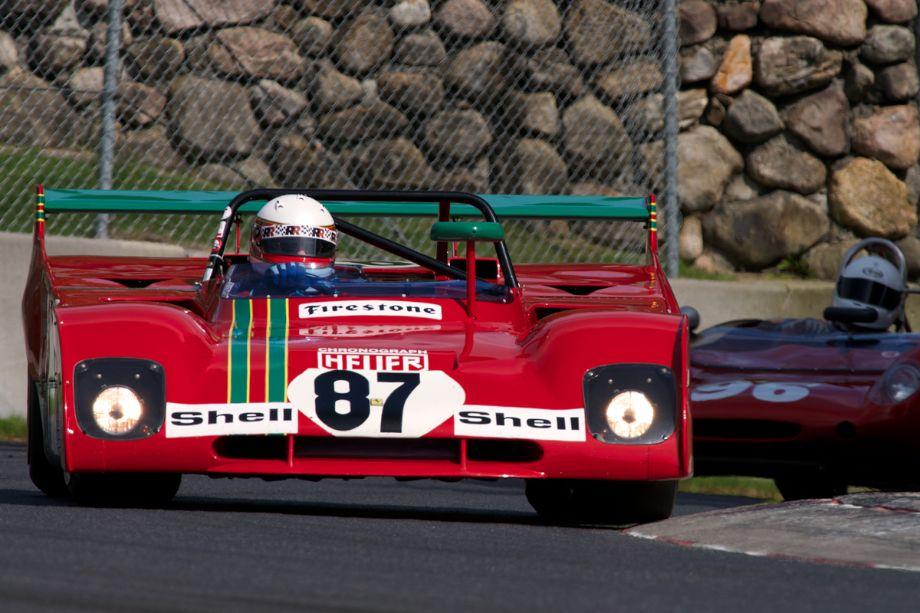 With headlights blazing Steven Read's Ferrari 312PB leads Jim Roth's Lotus 23 through turn twelve.