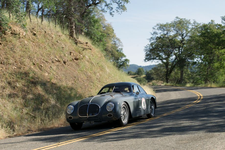 Hard into on of the HWY 36 turns goes the 1942 Alfa Romeo 6C 2500 SS Berlinetta Aerodinamica 911513. Richard Mattei and Mark Ronfeldt pushed the big Alfa Romeo through the turns and down the straights. (Photographer: Dennis Gray)