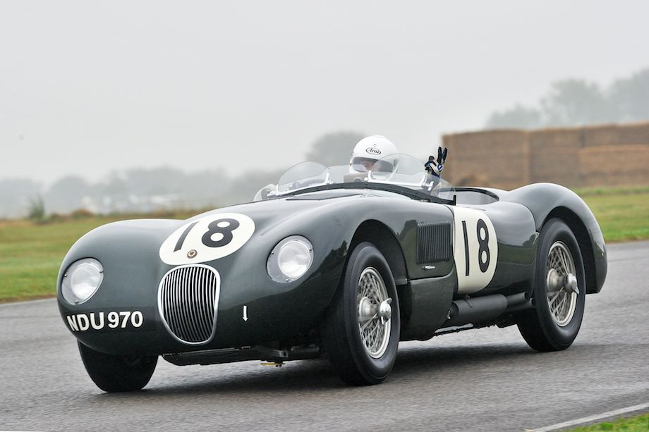 Smile For The Camera - Jaguar C-Type driver says hello at the Goodwood Revival (photo: Tim Scott)