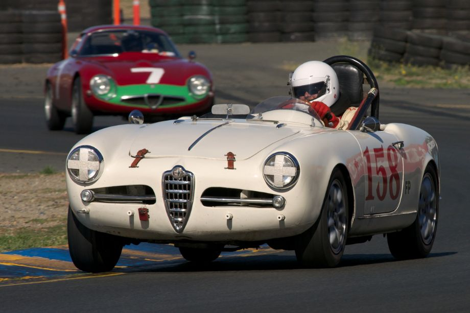 Robert Bogle's 1958 Alfa Romeo Giulietta Spyder exits turn ten.