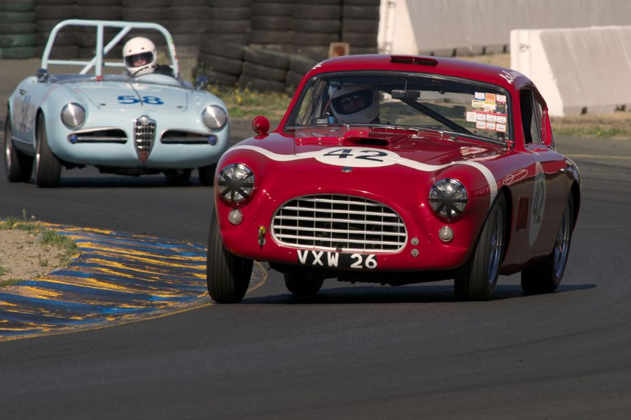 Always fun to watch, Rob Fisher lets it all hang out in his 1957 AC Aceca exiting turn ten.