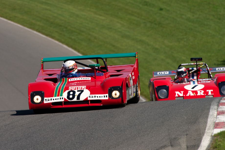 Steven Read's Ferrari 312PB leads John Goodman's Sparling Ferrari Special into turn fourteen.