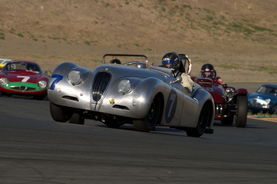 Dave Olson's 1950 aluminum bodied Jaguar XK120 up the hill into turn two.