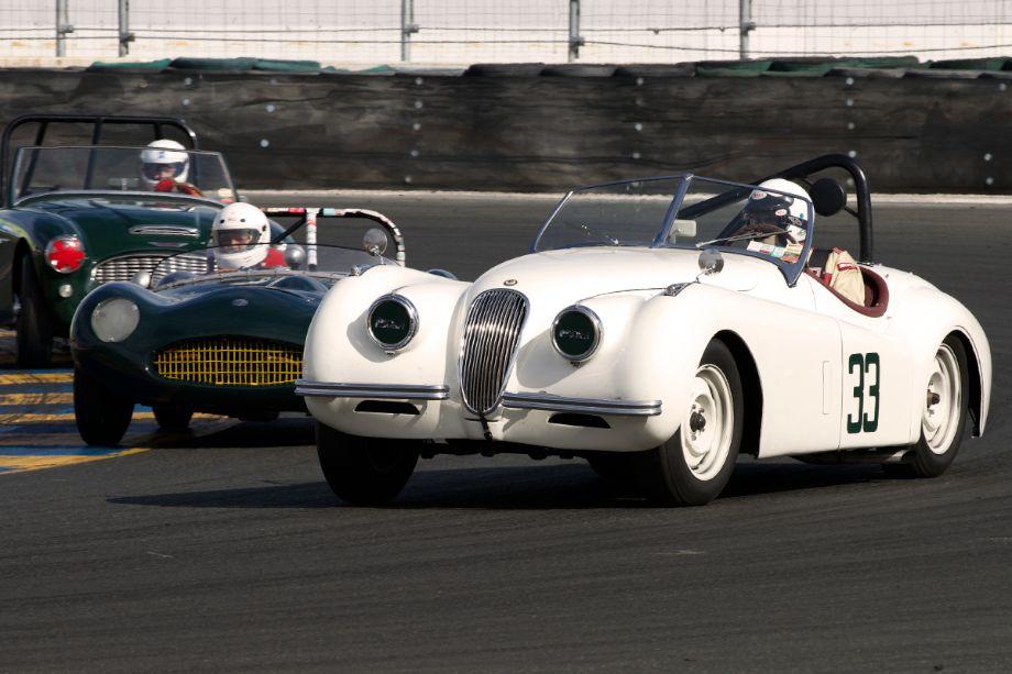 James Alder's 1952 Jaguar XK120 leads through turn eleven during Sunday's Group 1 race.