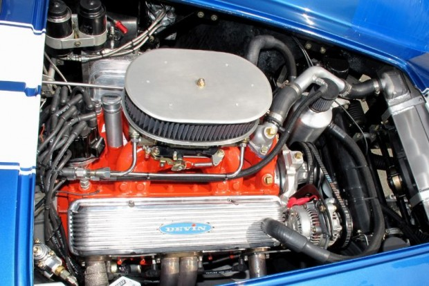 The 327 cid V8 Corvette engine in John Goodman's Devin SS with its 4-barrel Holley makes 500 bhp. William Edgar Photo