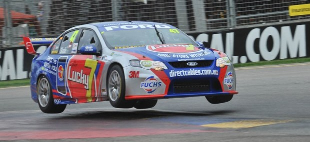 V8 Supercars Ford Falcon of Tim Slade jumps in Turn 2
