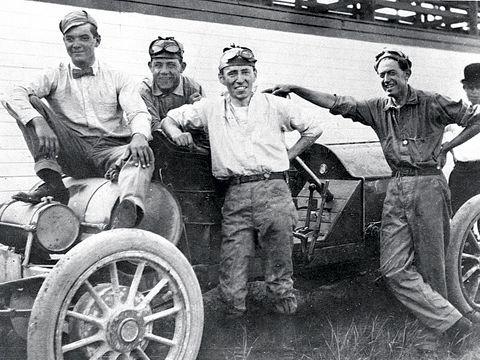 Louis Schwitzer (center)