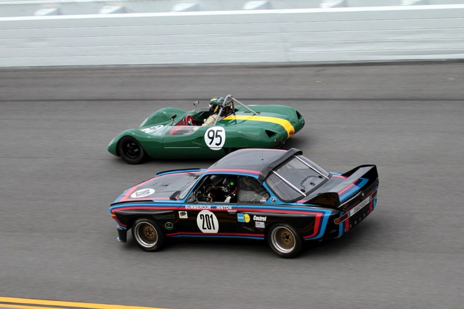 Lotus 23 and BMW CSL heading to the finish line