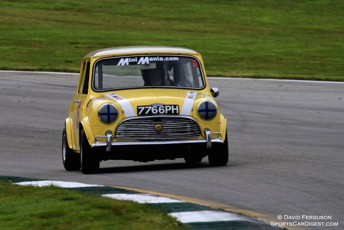 Phil Wicks aims his 67 Austin Mini Cooper S to the turn 12 apex,