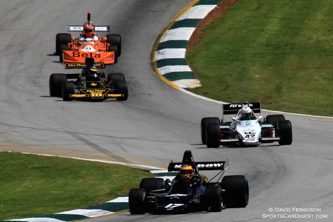 "Vintage Formula 1 cars going through the ""Esses""."