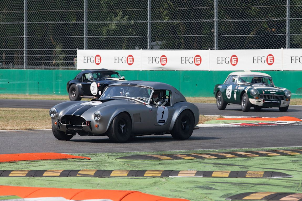 A couple of AC Cobras making a MG B Sandwich at Monza Historic 2015