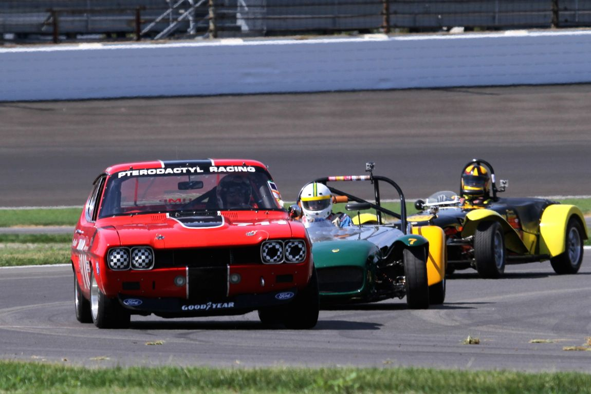 Ira Schoen, 71 Ford Capri ahead of two Lotus Sevens.
