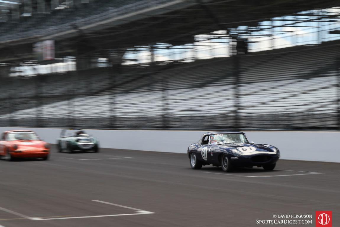 Jaguar, Porsche and Austin-Healey Sprite at speed.